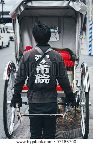Yufuin Fukuoka, Japan - February 21, 2012: Japanese Rickshaw Man Tourist Visitor Rides  In Town