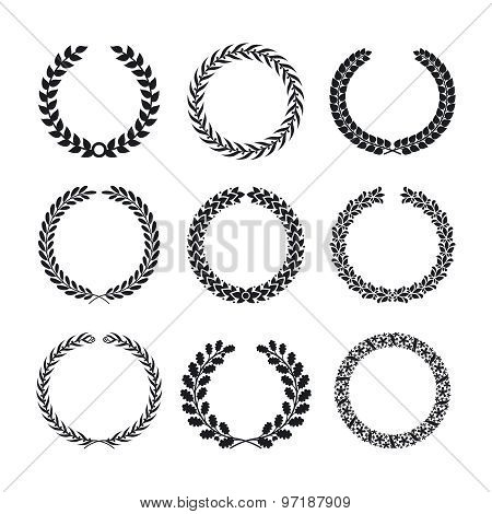 Black silhouettes of circular laurel foliate and wheat wreaths
