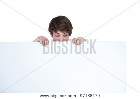 Handsome man holding blank panel on white background