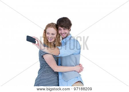 Happy couple tacking a selfie on white background