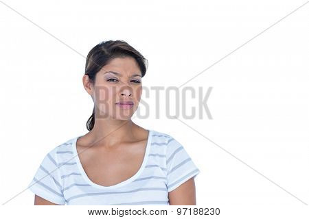 Pretty brunette looking at camera on white background