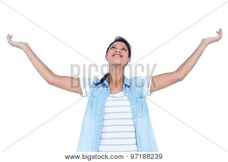 A pretty blonde woman relaxing on white background