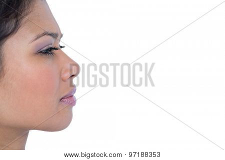 Close-up view of pretty brunette face on white background