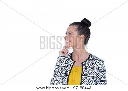 Happy pretty brunette thinking with hand on chin on white background