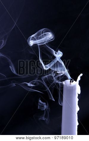 Whimsical Shape Of The Smoke Of An Extinguished Candle