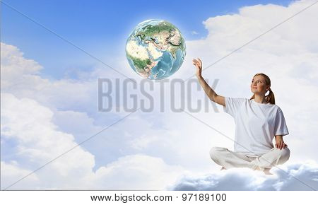 Young woman representing soul balance and meditation concept. Elements of this image are furnished by NASA