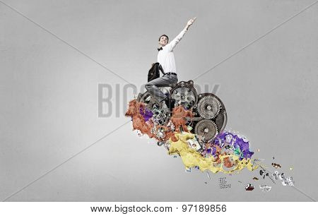 Young businessman with suitcase riding gears mechanism