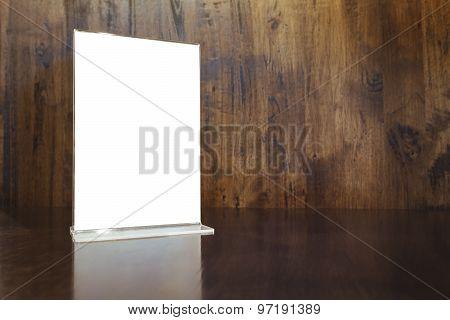 Mock up Menu frame on Table Wooden background