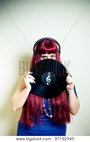 Young Pretty Woman Looking With Headphones And Vinyl Record