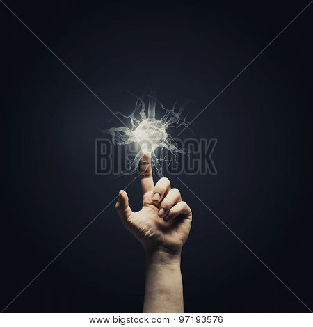 Close up of male hand touching icon on screen