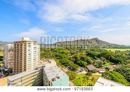 Apartment or hotel buildings in Honolulu, Hawaii, USA. Tropical city vacation background.