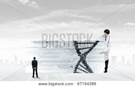 Young doctor with white banner presenting molecule research