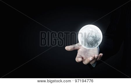 Close of man hands holding moon planet