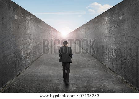 Businessman Walking One Way Road Toward Exit Sun Sky View