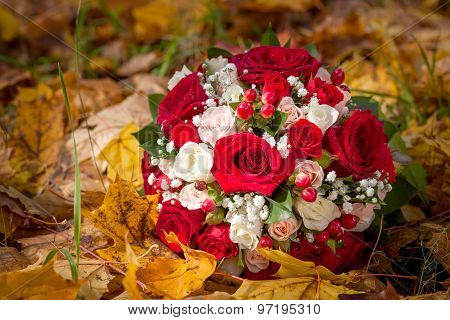 The Wedding Bunch Of Flowers Lies On Fallen Leaves.