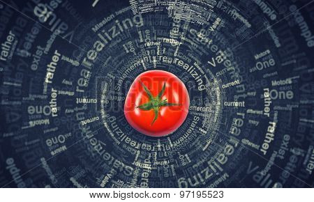 Tomato against black background with business sketches