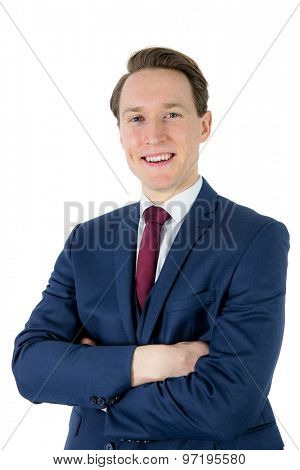 Happy businessman looking at camera with arms crossed on white background