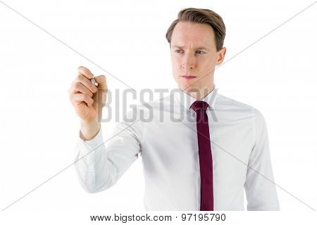 Businessman writing something with chalk on white background