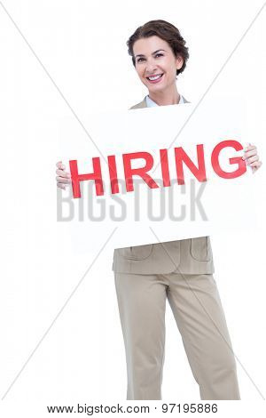 Businesswoman holding a hiring sign against a white screen