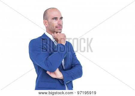 Businessman thinking with hand on chin against a white background