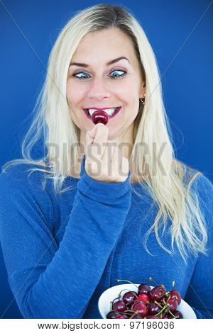 Blond Cross-eyed Woman Eating A Cherry