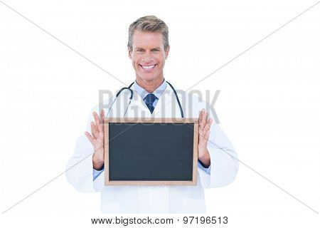 Portrait of a doctor holding a boardl against a white background