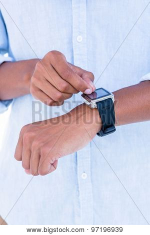 Close up of hipster using his smartwatch on white background