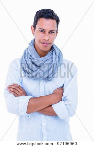 Handsome hipster smiling at camera on white background