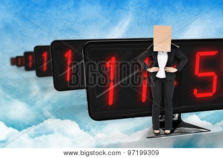 Businesswoman with box over head against painted sky