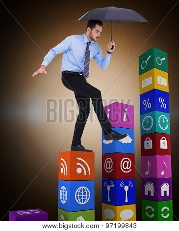 Focused businessman holding umbrella and balancing against orange background with vignette