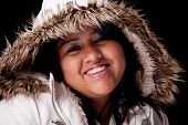 Portrait Of A Young Latin Woman With A Furry Hood , In Autumn/winter Clothes, Isolated On Black. Stu poster