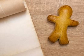 pic of gingerbread man  - Gingerbread man with a vintage parchment for placing text - JPG