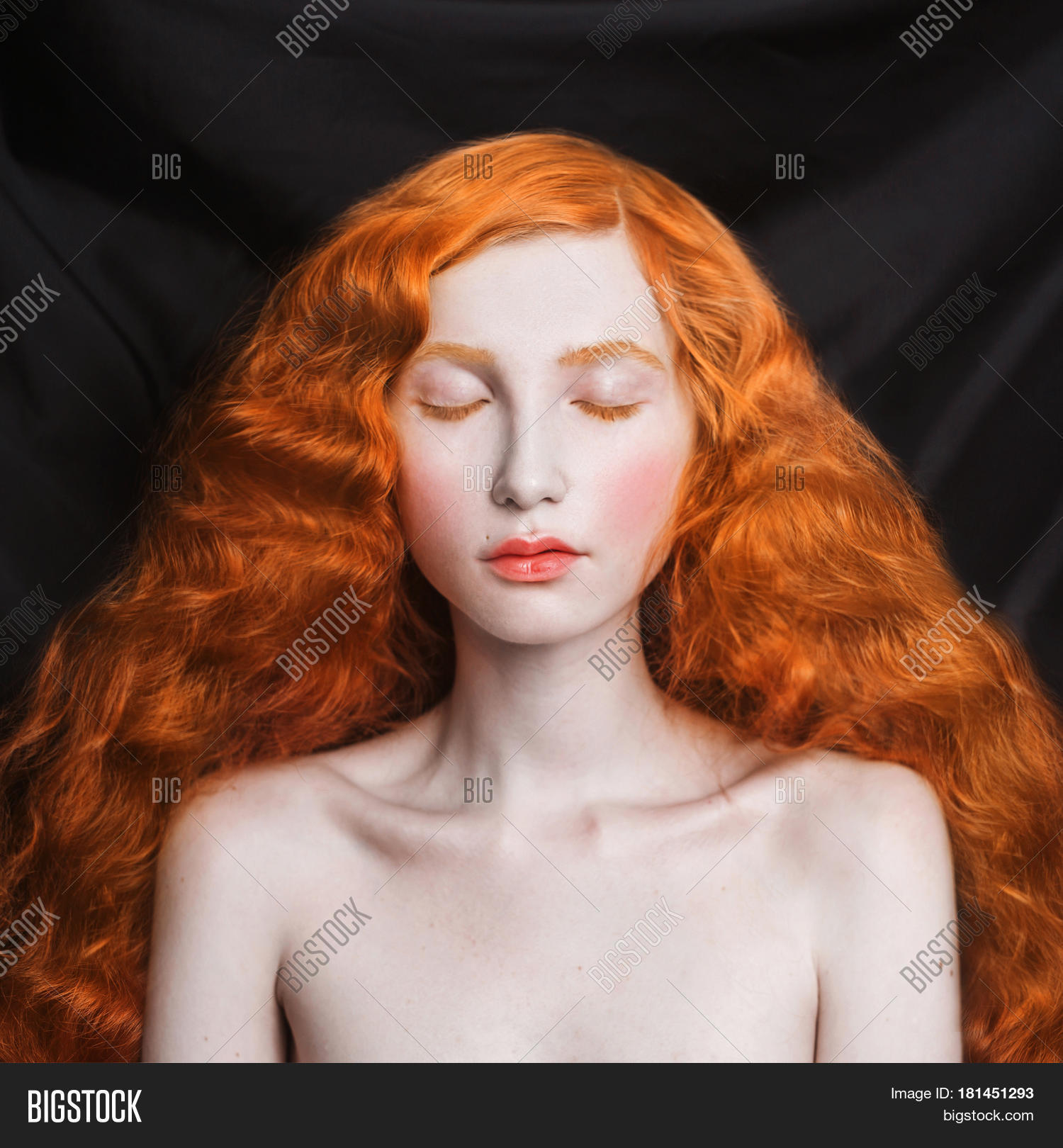 curly pale redhead