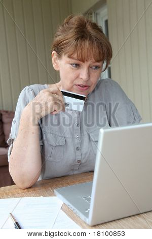 Senior woman doing online shopping