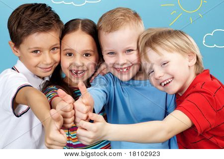 Group of adorable boys and girl showing thumbs up altogether