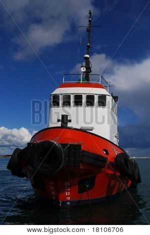 Red Tugboat At Anchor