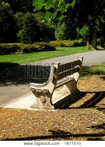 Empty Stone Bench In Public Park