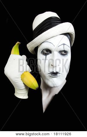 Mime In White Hat Holding A Banana In His Hand