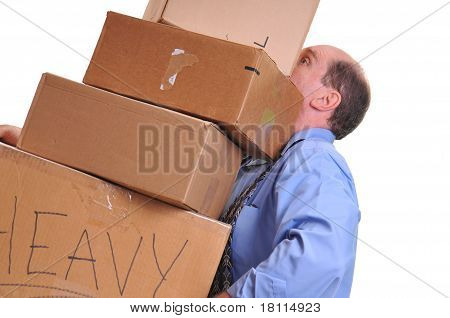 Man carrying heavy boxes.