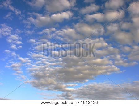 Bright Sky Filled With Fluffy Clouds