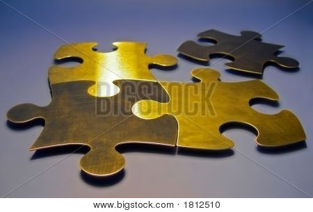 Golden Puzzle Pieces