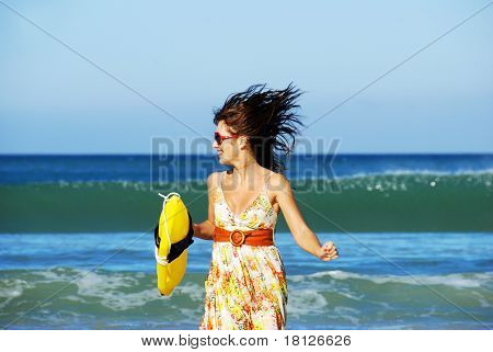 Summer Girl Playing On The Beach