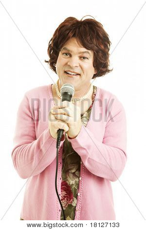 Cross dressing celebrity impersonator performs a song.  Isolated on white.
