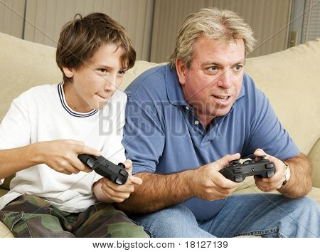 Uncle and nephew (or father and son) playing video games together.