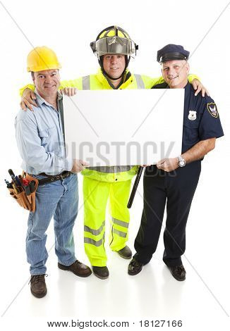 Blue collar workers - firefighter, policeman, and construction worker - all holding a blank sign, ready for your text.  Full body isolated.