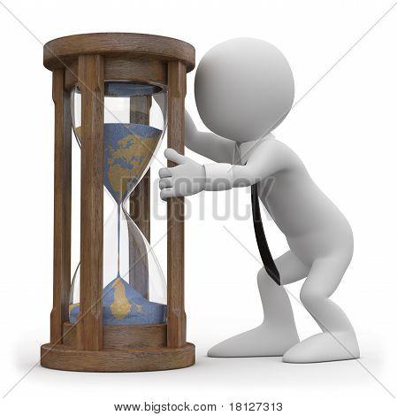 A man watching an hourglass