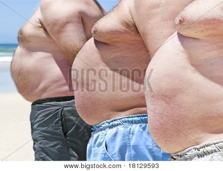 Close Up Of Three Obese Fat Men