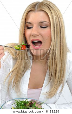 Pretty Woman Eating Green Vegetable Salad. Isolated On White