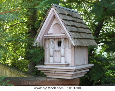 Bird House In Woodsy Setting