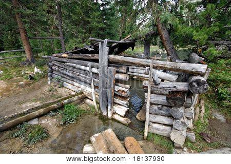 Mineral bath in Siberia. Sayan mountains. Russia.